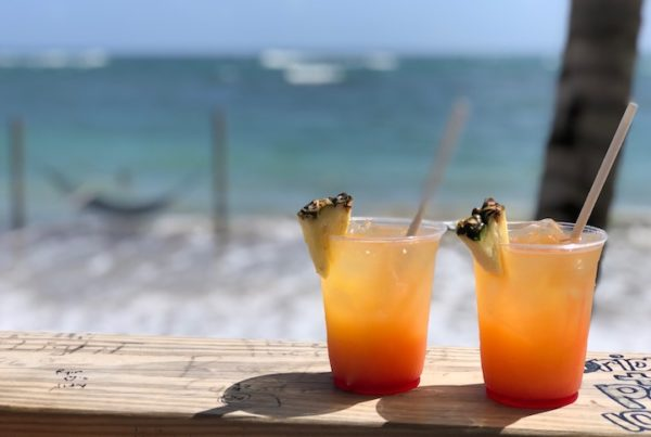 Rum drinks of some style beside the Caribbean Sea at Paradise Beach bar